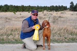 Aaron and Kosmo celebrating their 3rd placement in the Amateur Gun Dog stake in the Rocky Mountain Vizsla Club's Inaugural Walking Field trial.